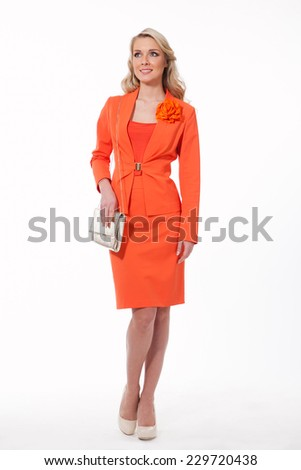 beautiful blond fashion business woman model in orange autumn suit