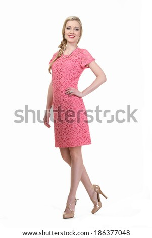 beautiful blond fashion business woman model in pink dress isolated on white