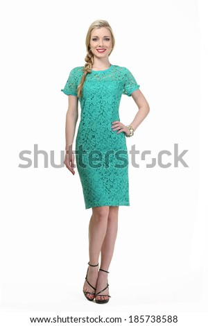 beautiful blond fashion business woman model in summer green dress  isolated on white