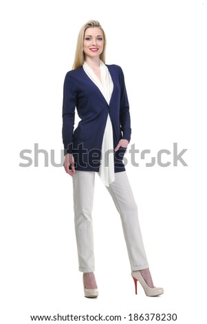 beautiful blond fashion business woman model in summer suit with white trousers isolated on white