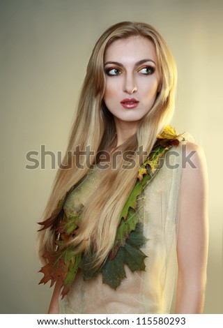 beautiful blond female model young woman wearing carnival dress dryad