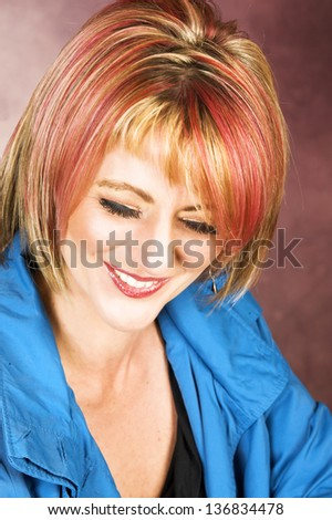 Beautiful blond female with red streaks in her hair - stock photo