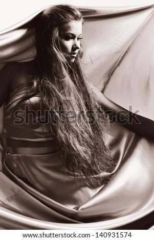beautiful blond girl in a silk dress - stock photo