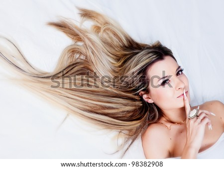 Beautiful blond girl in studio - stock photo