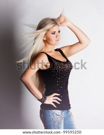 Beautiful blond girl in studio - stock photo