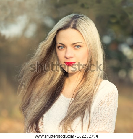 beautiful blond girl in the park - stock photo
