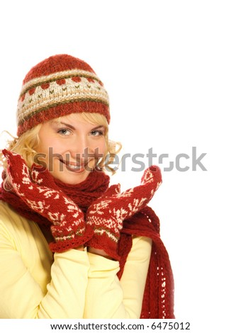 Beautiful blond girl in winter clothing. Isolated on white background