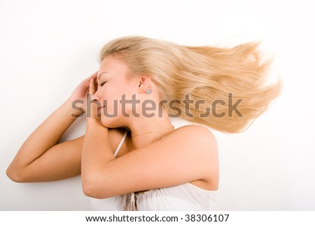 Beautiful blond girl sleeping over white background - stock photo