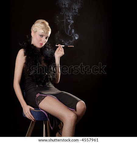 beautiful blond girl smoking in the dark