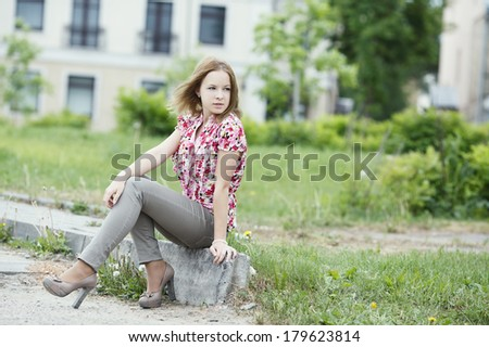 beautiful blond girl urban portrait - stock photo