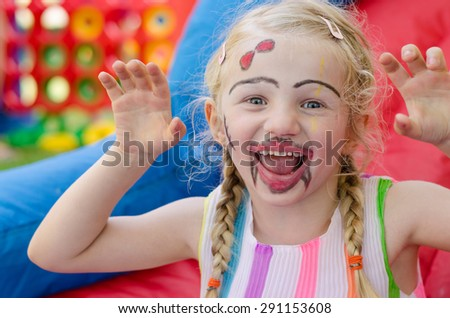 beautiful blond girl with colorful face-painting