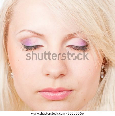 Beautiful blond girl with eyes closed and beautiful make-up
