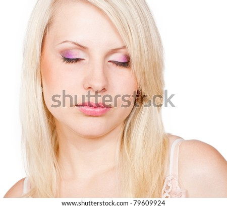 Beautiful blond girl with eyes closed and beautiful make-up. Isolated on white background