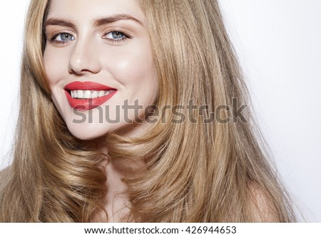 beautiful blond girl with red lips smiling on the white background