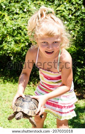 beautiful blond girl with turtle image