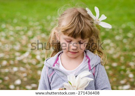 beautiful blond girl with white flower in hair - stock photo
