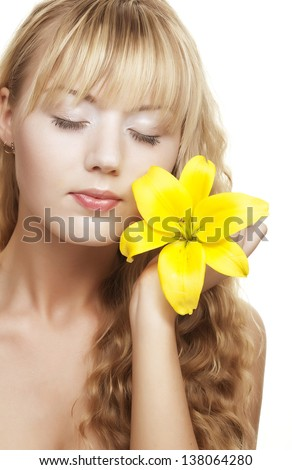 beautiful blond girl with yellow lily isolated on white - stock photo