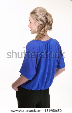 beautiful blond model girl with stylish modern plait and blue blouse