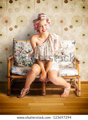Beautiful Blond Pin-up Girl Smiling While Getting New Curly Hairstyle At Retro Hairdresser - stock photo