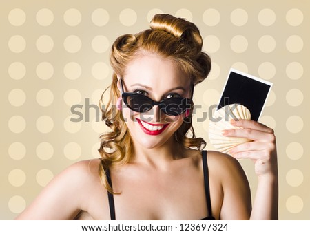 Beautiful Blond Pinup Girl Advertising Holiday Deals And Specials On A Copyspace Photo In A Depiction Of World Travel - stock photo