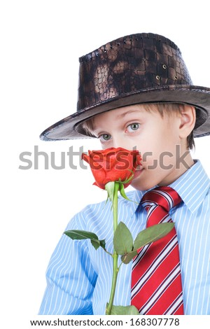 Beautiful blond romantic boy wearing a shirt and a tie holding red rose looking shy (valentine concept) - stock photo