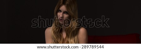 Beautiful blond sexy girl with alluring look - stock photo