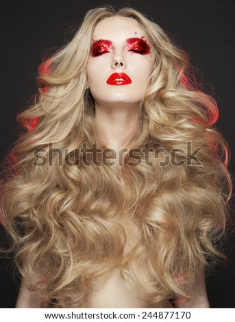 Beautiful Blond Woman. Curly Long Hair,brigth make up,red lips,red shadow,art style,Fashion model with long blond hair. - stock photo