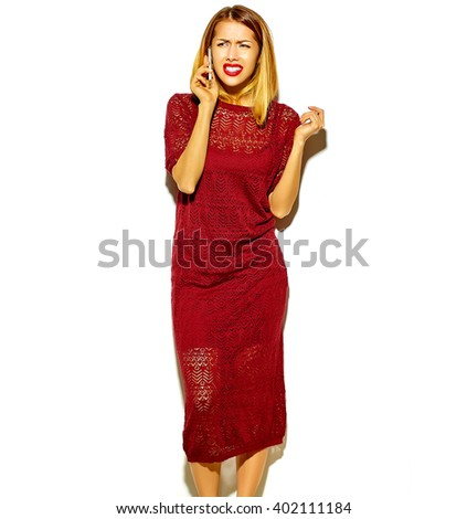 beautiful blond woman girl in red dress with makeup speaking on phone isolated on white - stock photo