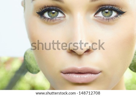 Beautiful blond woman. green eyes. soft make-up
