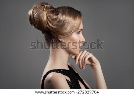 Beautiful Blond Woman. Hairstyle and Make-up. - stock photo
