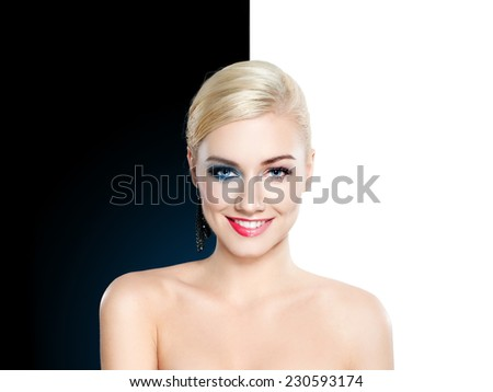 Beautiful blond woman half clean and half face with make up - glamour concept - stock photo