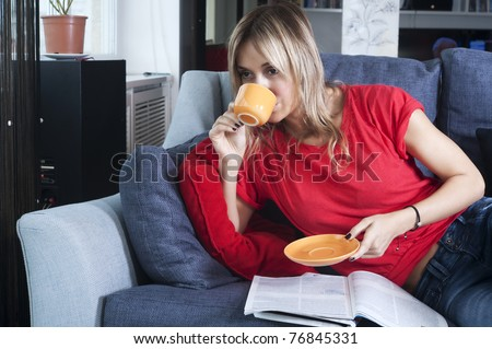 beautiful blond woman having her morning coffee - stock photo
