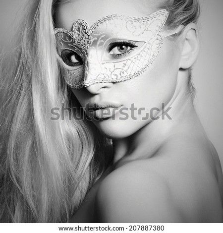 Beautiful Blond Woman in a Carnival Mask.Masquerade. Monochrome girl - stock photo