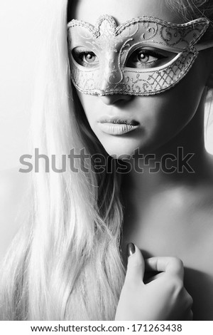 Beautiful Blond Woman in Carnival Mask.Masquerade. Sexy Girl. Beauty & Fashion. Black & White - stock photo