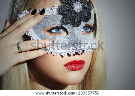 Beautiful Blond Woman in Carnival Mask.Masquerade. Sexy Girl with blue eyes. Lovely.Manicure Nail - stock photo