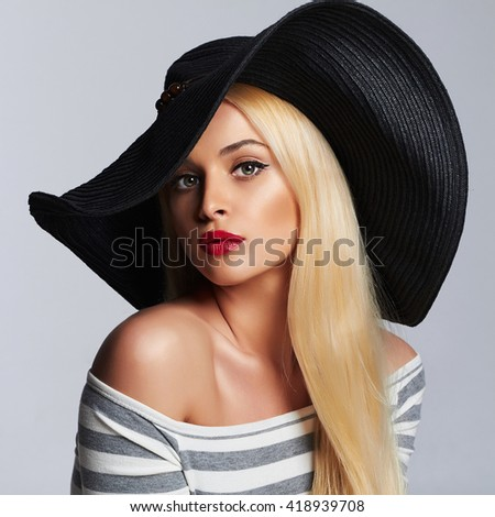 Beautiful blond woman in hat. summer fashion beauty model girl - stock photo
