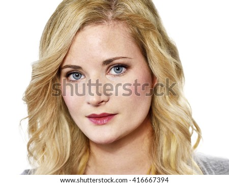 Beautiful blond woman looking into the camera. Young woman with copy space, isolated on white background. - stock photo