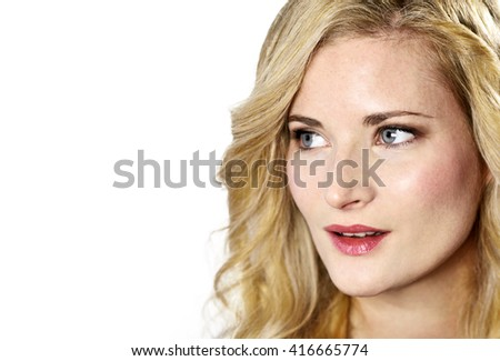 Beautiful blond woman looking to the side. Positive Emotions. Young, laughing woman with copy space, isolated on white background. - stock photo