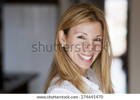 Beautiful blond woman smiling at the camera - stock photo