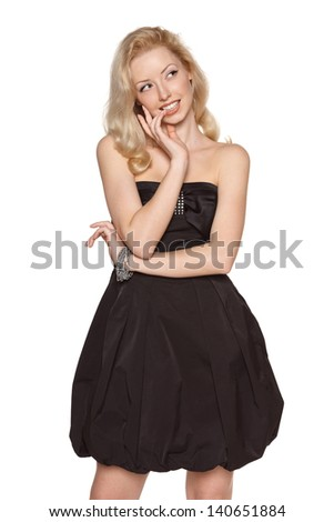 Beautiful blond woman struggling to make her choice,  biting her nails and looking away, against white background - stock photo