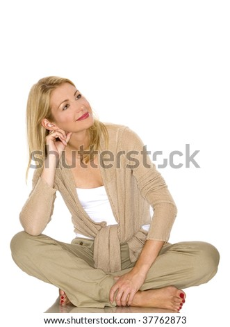 beautiful blond woman wearing beige outfit on white - stock photo