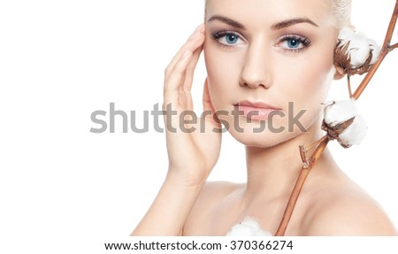 Beautiful blond woman with cotton flowers-skin care concept