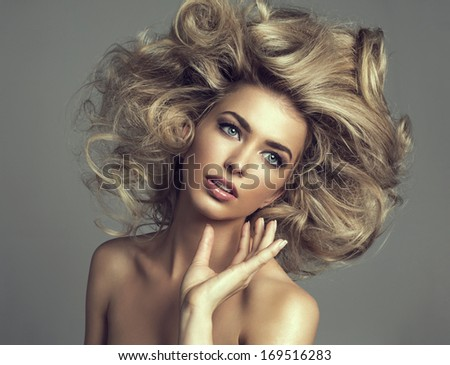 Beautiful blond woman with curly long hair