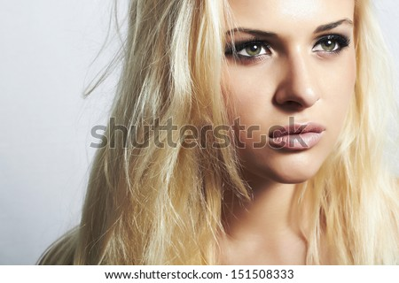 Beautiful blond woman with disheveled hair.professional make-up. beauty girl