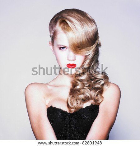 Beautiful blond woman with elegant black dress. Fashion photo - stock photo