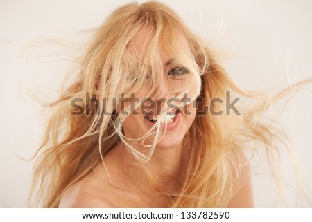 Beautiful blond woman with fluttering hair - stock photo