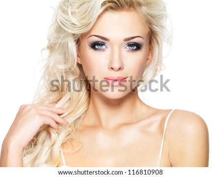 Beautiful blond woman with long curly hair - isolated on white. Portrait of fashion model.