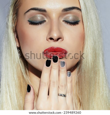 Beautiful blond Woman with Manicure. Sexy Beauty Girl. Nail design. Make-up. Beauty salon.close-up face - stock photo