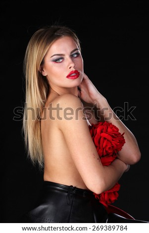 Beautiful blond woman with naked back and flowers - stock photo