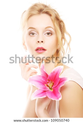 Beautiful blond woman with pink lily high-key portrait - stock photo